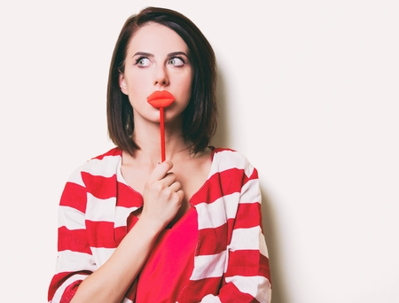 portrait of the beautiful young woman with lip shaped toy Stock Photo