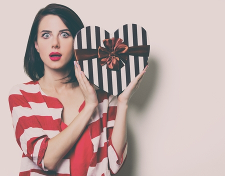portrait of the beautiful young woman with heart shaped gift Stock Photo
