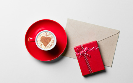 shaped: cup of coffee, gift and envelope Stock Photo