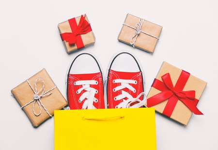 big red gumshoes in cool shopping bag and beautiful gifts