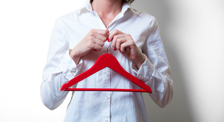 photo of beautiful young woman with red hanger Stock Photo