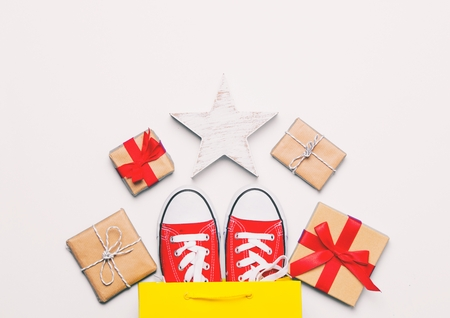big red gumshoes in cool shopping bag, star shaped toy and beautiful gifts