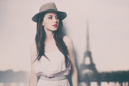 portrait of the beautiful young woman in hat