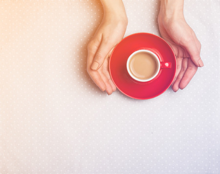 scratched: Female hands holding cup of coffee. Stock Photo