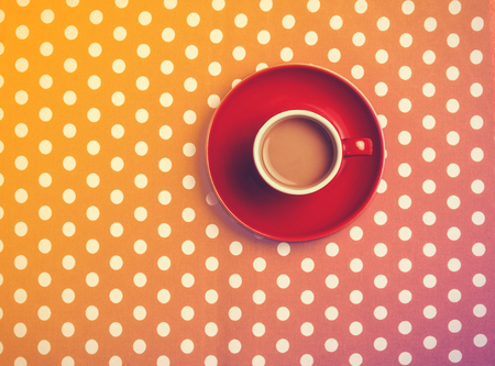 scratched: cup of coffee on speckled background.