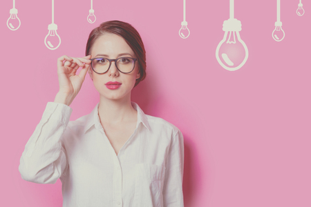 Beautiful red-haired businesswoman on pink background Stock Photo