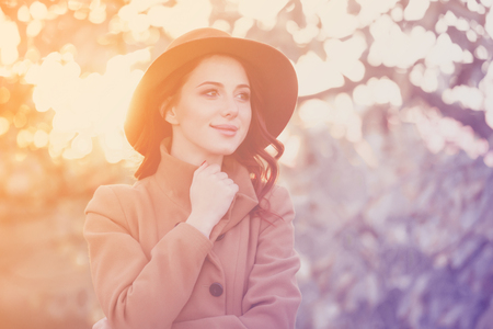 Woman in hat and coat in autumn time outdoor Stock Photo