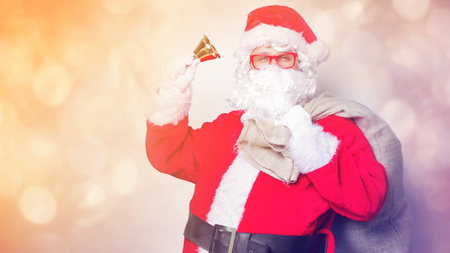 Funny Santa Claus have a fun with bell on blue background