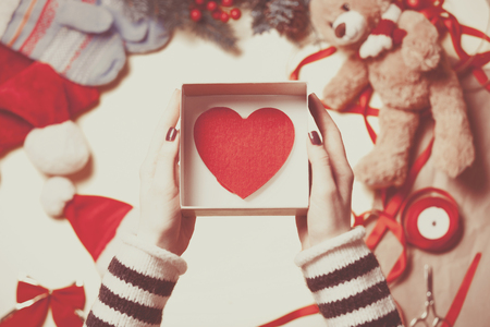 stock photo woman wrapping a heart shape toy as a christmas gift high point of view