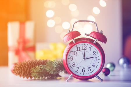 Vintage Alarm clock with Christmas gift and Ligths on background Stock Photo