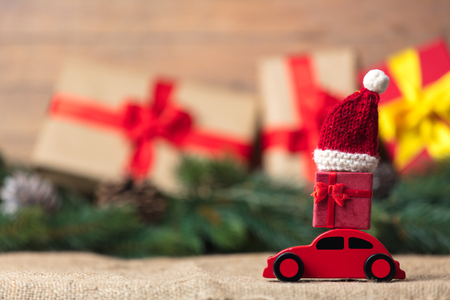 Christmas gifts and red car toy with Santa Claus hat  Stock Photo