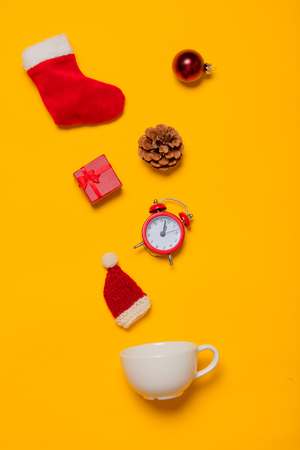 white cup with Christmas decoration on yellow background