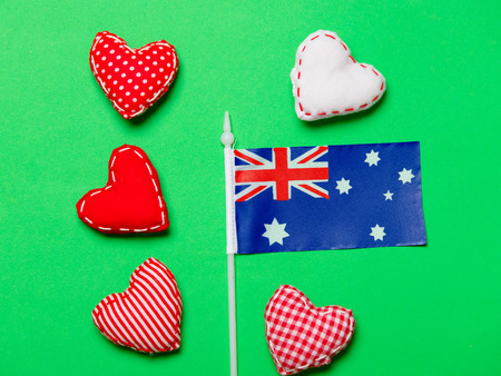 Valentines Day heart shapes and flag of Australia on green background Stock Photo