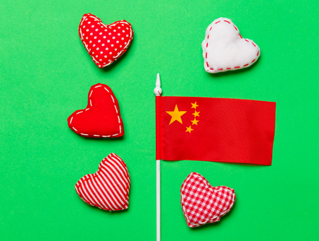 Valentines Day heart shapes and flag of China on green background