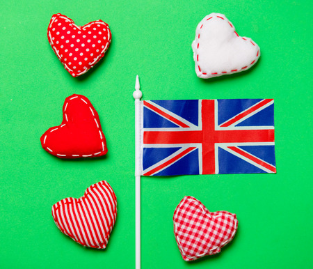 Valentines Day heart shapes and flag of Great Britain on green background