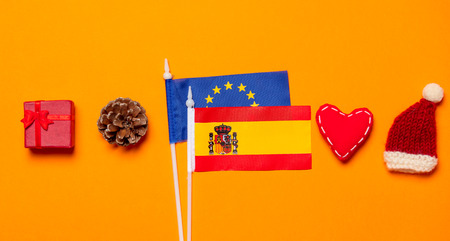 Spain and Europe Union flags with Christmas gifts on orange background Stock Photo