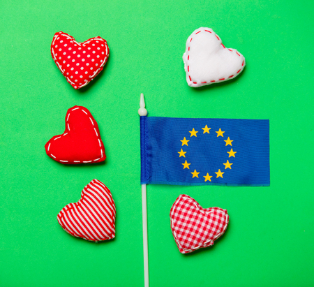 Valentines Day heart shapes and flag of Europe Union on green background