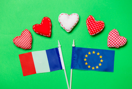 Valentines Day heart shapes and flag of Europe Union and France on green background Stock Photo