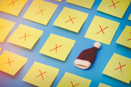 Color stickers and one selected Santa Claus hat on blue background