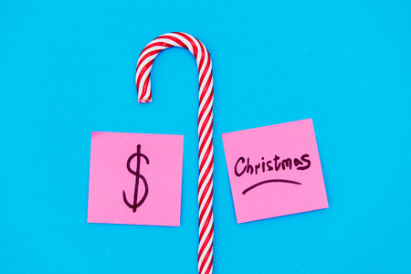 Christmas and dollar stickers with candy cane on blue background