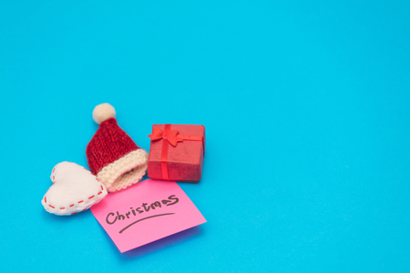 Pink sticker which inform about Christmas on blue background