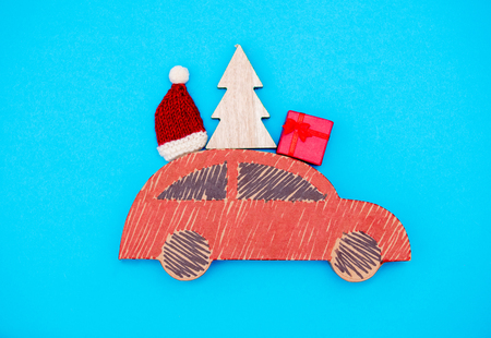 Red handmade car delivery with Christmas gifts on blue background Stock Photo