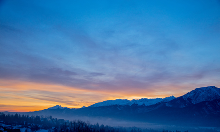 Sunrise over snow Tatry mountains in winter time.