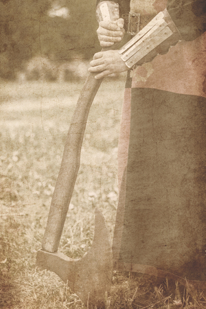 medieval armed knight with axe. Image in old color style