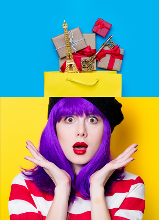 Collage portrait of a young woman with purple hair and bag with gifts on yellow and blue backgrounds