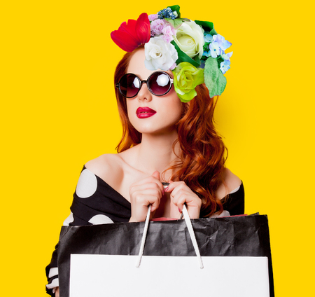 Collage of redhead woman in sunglasses with shopping bag and flowers on head on yellow background