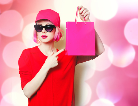 portrait of beautiful young woman with shopping bag