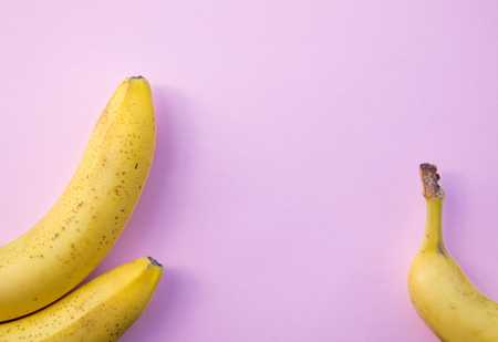 yellow banana on clear pink background. Above view Stock Photo