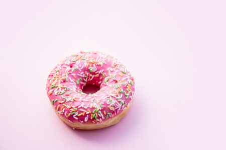 Fresh sweet donut on pink background. Abive view Stock Photo