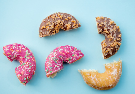 Sweet cut donuts on pink background isolated. Above view Stock Photo