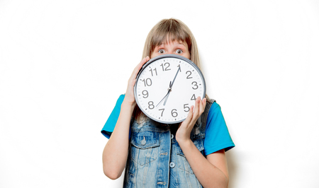 Portrait of young sad teenage girl with clock on white background 스톡 콘텐츠