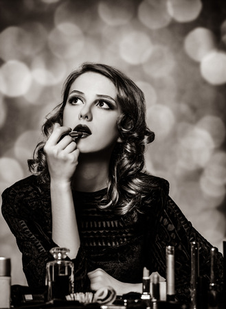 Woman applying cosmetics. Image in black and white color style Archivio Fotografico