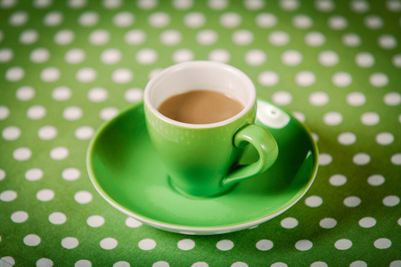 Green a cup of coffee on polka dot cover 스톡 콘텐츠