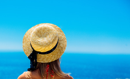 Young girl in bikini on terrace with blue sea and sky on background. Crete, Greece 스톡 콘텐츠 - 114957668