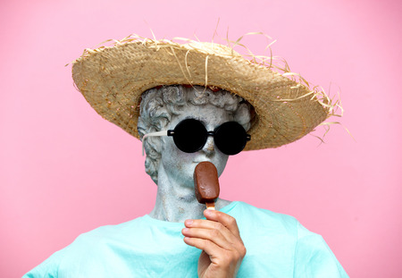 Antique bust of male in hat with ice-cream on pink background. Ready for summer vacation
