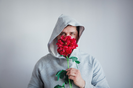 hesitate man with Peony flower on gray background Stockfoto