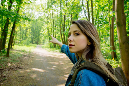 Young woman with backpack in a mixed forest Beskidy in Poland in spring time. 版權商用圖片