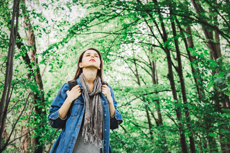 Young woman with backpack in a mixed forest Beskidy in Poland in spring time. Stok Fotoğraf