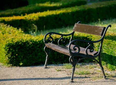 Classic bench in a city garden, Side view