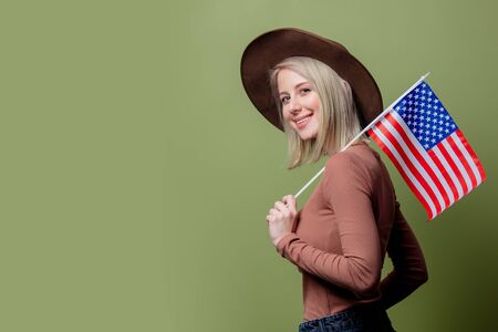 Beautiful cowgirl in a hat with United States of America flag Stock Photo