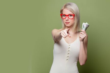 Beautiful blonde girl in glasses with money Reklamní fotografie