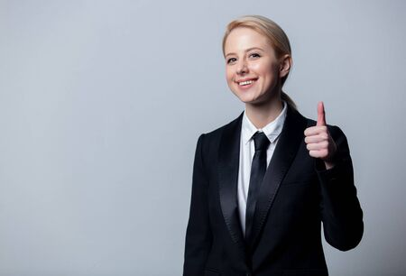 Smiling businesswoman in a classic black business suit