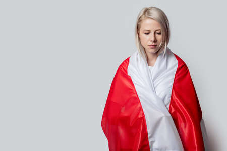 woman with national Belarus flag on white background