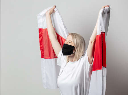 woman in face mask with national Belarus flag on white background Archivio Fotografico