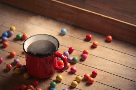 Side view on cup of coffee and Easter eggs on wooden table