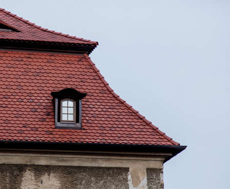One small window in a roof a castle in Poland, Europe Zdjęcie Seryjne